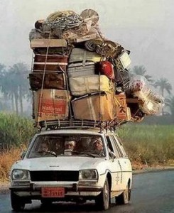 car-with-too-many-suitcases-balanced-on-top