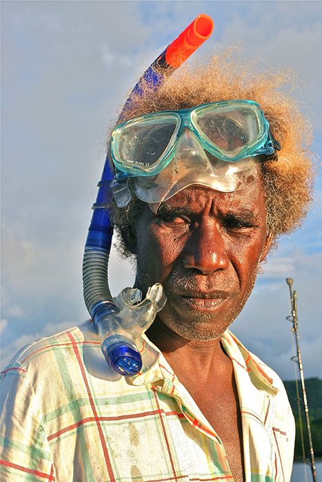 In Marau Sound, Solomon Islands, a group of aquarium fishers and farmers, like the one pictured here, has been sustainably farming coral and collecting fishes for the marine aquarium trade since the 1990s. The aquarium trade has been the primary and most consistent source of income for the village. Photo by Ret Talbot.