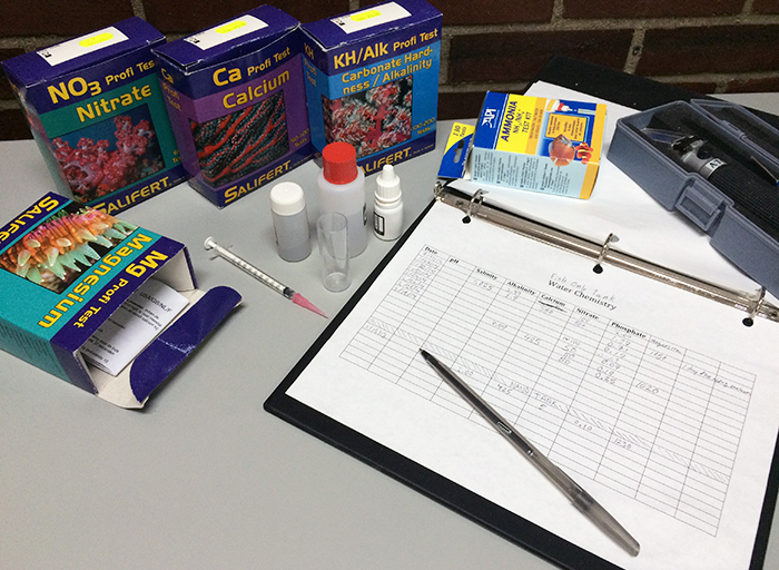 A collection of various aquarium testing kits and tools. Photo by Brian Cook.