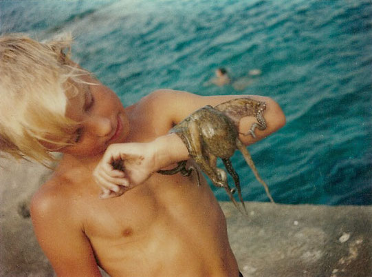 Jason at age 7 with his first pet octopus.