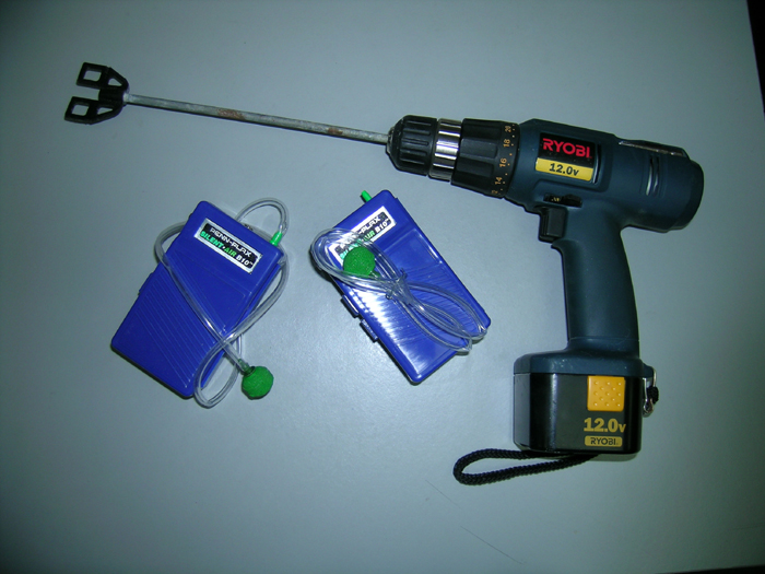 Paint stirrer on a cordless drill and battery powered air stones.
