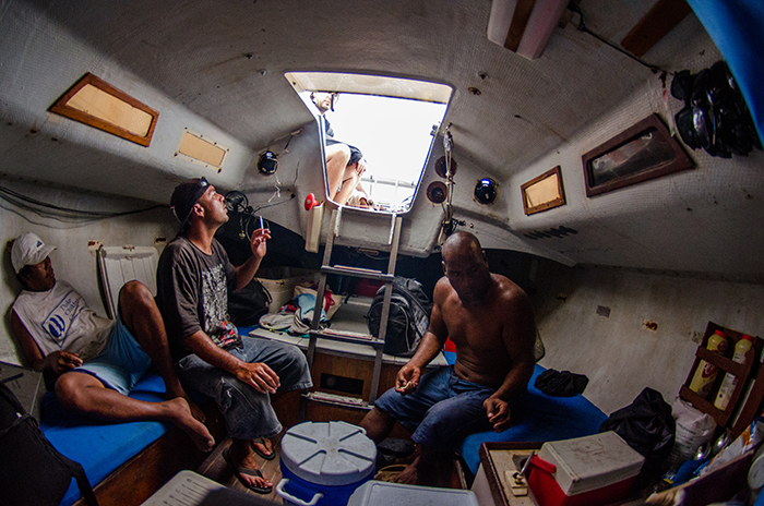 Inside of the sail boat, incredibly small and hot.