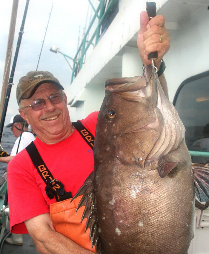 Jerry McGrath holding a snowy grouper aboard the Viking Starship out of Montauk, NY.