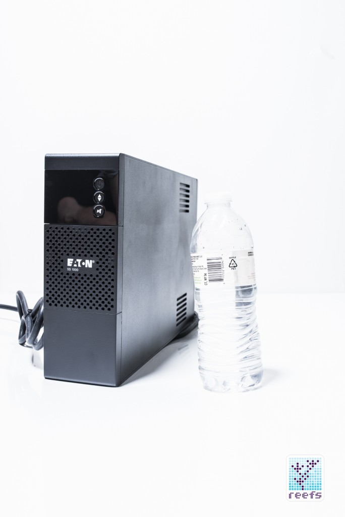 Eaton 5S 1000 UPS next to a 0.5 liter water bottle