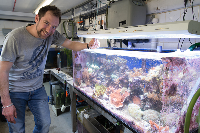 Jamie with a tank of various corals for use in the exhibits. Photo by Richard Aspinall.