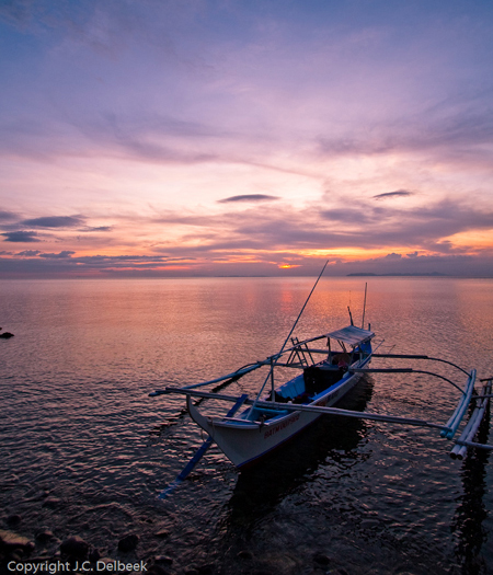 A banka awaits the dawn of a new day in the Philippines. Photo by J. C. Delbeek.