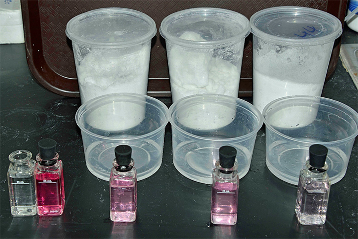 DPD chlorine test on three brands of sea salt – left to right; brands A, B, and C. Lighter pink color indicates less chlorine present after mixing. The dark pink vial on the left is the tap water control.